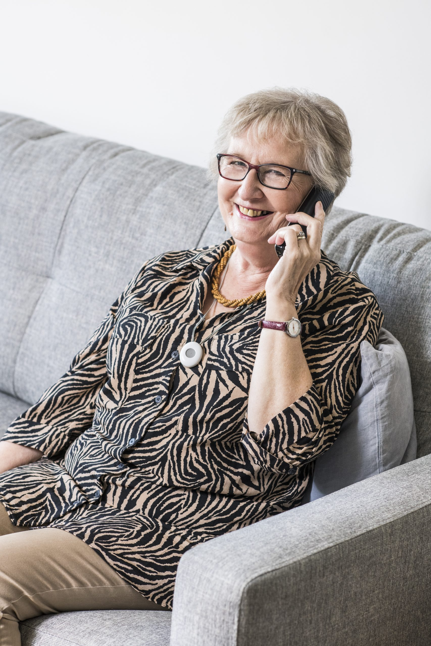 Older woman holding cordless phone to her ear