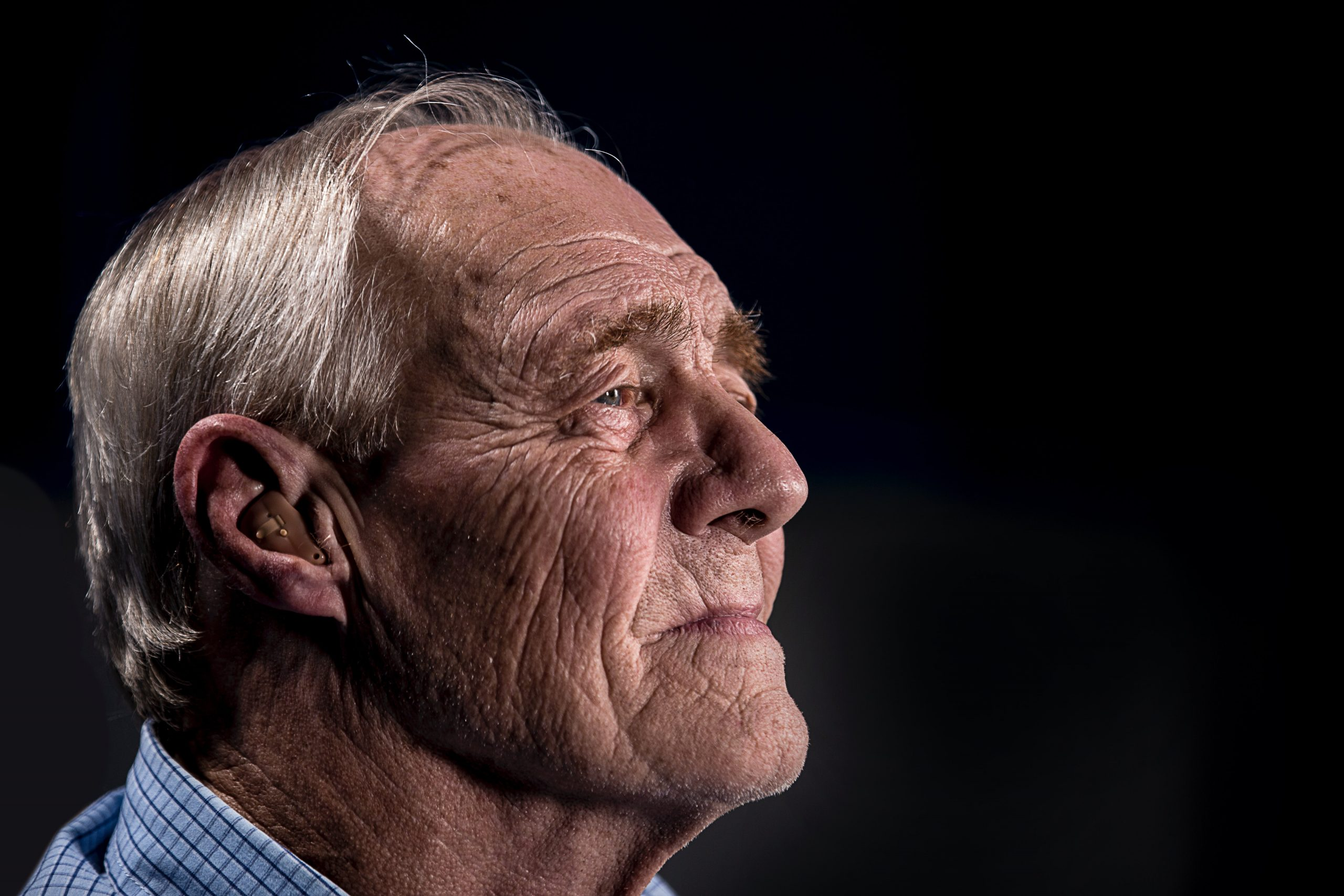 Old man wearing a hearing aid