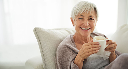 Shot of a senior woman enjoying a relaxing coffee break on the sofa at home