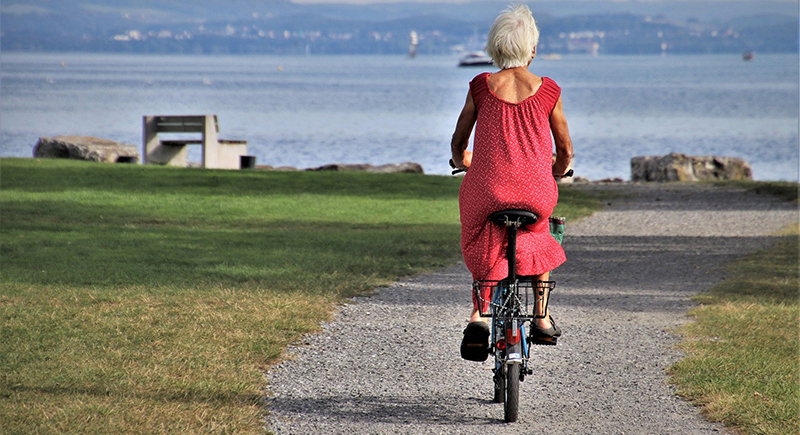 Elderly woman riding a bicycle