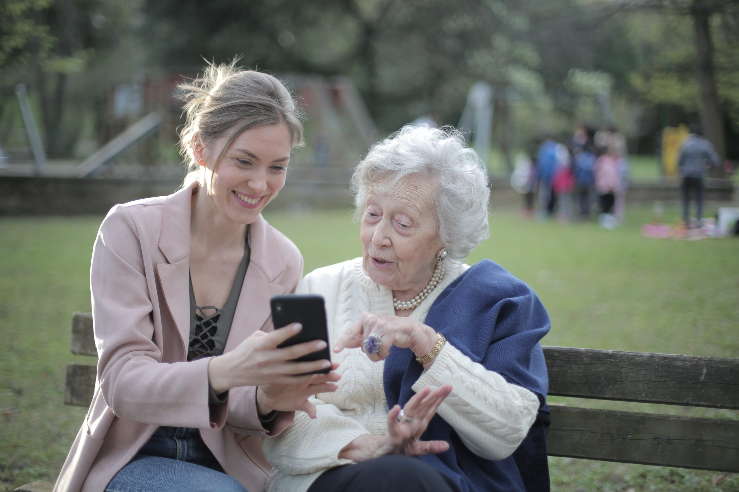 Young woman with her grandmother on a bench